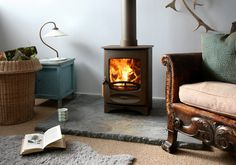 Wood burning, multi-fuel & gas stoves Glasgow at Stove World Glasgow. We stock Charnwood & Contura stoves with live displays in our Glasgow stove showroom. Wood, Traditional Fireplace, Retro Living Rooms, Mantel Design, Contemporary Fireplace, Modern Wood, Stove, Solid Fuel Stove, Wood Stove