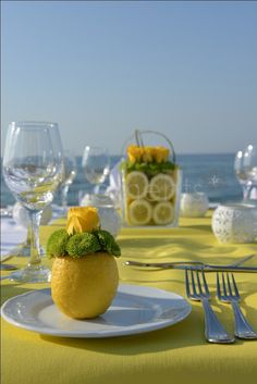 Pick a theme color & run with it! Here lemons & broccoli add an organic, fresh element, & the yellow roses bring in a touch of elegance.