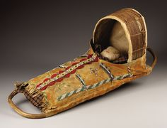AN APACHE BEADED HIDE CRADLE. . c. 1900. ... American Indian | Lot #77053 | Heritage Auctions