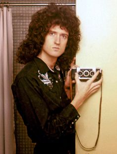 Queen guitarist Brian May is set to delight fans with the release of a new book, which includes never-seen-before images of the group from his personal photo archive. Pictured: May in a hotel room in 1978 with one of the stereoscopic cameras that the musician carried during the height's of the band's fame