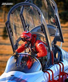 Turkish Stars pilot climbs out of the cockpit of a NF-5B fighter.