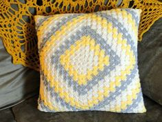 I made a new pillow! This was the easiest cover to make. Seriously. I make a granny square with 23 rounds and then tilted it to its side an...