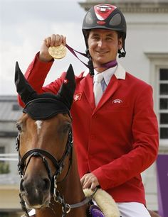 REPIN it if you love it! Steve Guerdat of Switzerland riding Nino des Buissonnets celebrating his gold medal after winning the equestrian individual jumping final. (Photo credits: Mike Hutchings/Reuters & NBC Olympics)