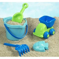 An adorable blue and green plastic set that has everything your little tyke needs for big time beach fun! Including a rake, shovel, mini dump truck and a sturdy bucket to hold everything, just add sand and water and get ready for the giggles to begin! Sand Toys, Water Toys, Toddler Travel, Toddler Fun, Sand And Water, Lake Water, Little Tykes, Baby Equipment, Toys