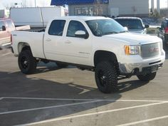 White lifted GMC Sierra Truck