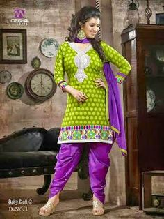 Beautifully Designed Green Patiyala Dress in Cotton with awesome embroidery work done. Comes along with Purple contrast matching finely embroidered Bottom and Duppatta.