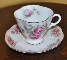 Roses Clarence Bone China Made in England mismatched with Pink Roses Royal Albert Bone China Saucer. Find it in this Etsy shop https://www.etsy.com/shop/IslandsInTheStream