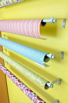 Gift wrap center using inexpensive curtain hardware.