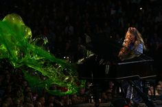 Delta Goodrem Photos Photos - Delta Goodrem performs as slime explodes out of her piano during the Nickelodeon Slimefest 2016 evening show at Margaret Court Arena on September 25, 2016 in Melbourne, Australia. - Nickelodeon Slimefest 2016 - Melbourne: Show