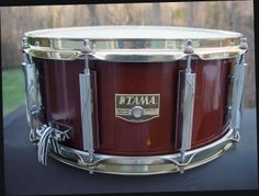 """Tama 6.5"""" x 14"""" Solid Maple Artwood snare drum, 3.5mm one-ply shell with reinforcement rings, Antique Brown poly lacquer finish Ten Freedom lugs, Brass Mighty Hoops, Cam Lever strainer system Drum was listed as model SM956 in the 1991 Japanese catalog and again in 1992 and 1993 as SM546"""