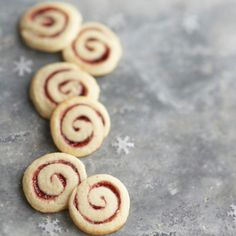 Linzer Pinwheels For pretty, Austrian-inspired cookies, slather buttery cookie dough with raspberry preserves, and then slice into spirals and bake. Make and share them all year long Köstliche Desserts, Holiday Cookies, Holiday Baking, Christmas Desserts, Christmas Baking, Delicious Desserts, Christmas Treats, Holiday Treats, Austrian Desserts