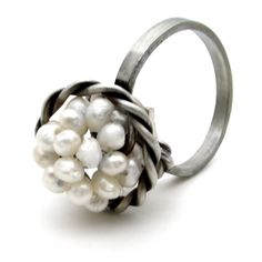 Small Pearl Ring in Sterling Silver.   Handmade rhodium plated sterling silver ring with pearls. Adjustable size.