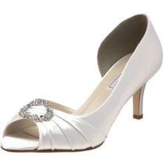 When you want a tres elegant evening shoe that will transcend trends, step into the Ivanna from Touch Ups. The low sweep of a d'Orsay side and generous peep toe show off a sexy bareness, while the pleated vamp adds more femme allure. A rhinestone brooch means every step will sparkle. How versatile is the white pair? You can easily dye it any color you desire.