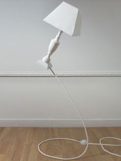 I want one of these lamps that is held in the air by its cord - COOL!