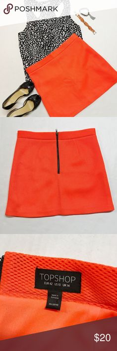 Topshop Size 10 neon orange skirt Size 10 neon orange skirt  Brand: TOPSHOP Excellent condition,  material polyester  length 17 inch Waist 16 inch Hips 19 Topshop Skirts Mini