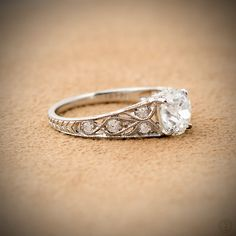 A stunning 1.49ct Old Mine Cut Diamond Engagement Ring, set in handmade platinum setting and adorned with filigree and diamonds.