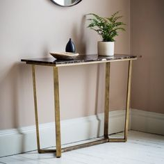 Emperor Marble Console Table  A contemporary console table featuring a rich brown Spanish Emperor marble top with distinctive yet subtle natural brown and white tones in the grain and a brushed bronze angled metal base. This neo classical style will suit a multitude of interiors.