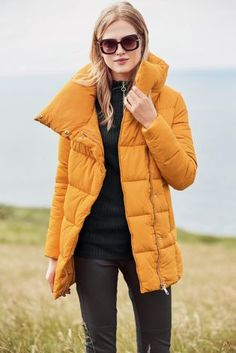 Who says you can't rock a bit of colour in the winter months? Not us! We're ALL about this yellow padded jacket.