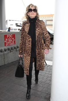 Jane Fonda holds her head high as she strolls through LAX in glamorous leopard…