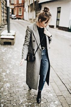 gray overcoat over some jeans.
