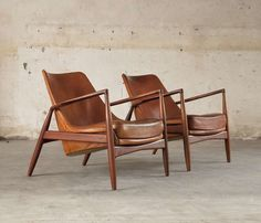 Pair Of 2 'seal' Lounge Chairs By Ib Kofod Larsen In Original Cognac Leather | From a unique collection of antique and modern lounge chairs at http://www.1stdibs.com/seating/lounge-chairs/
