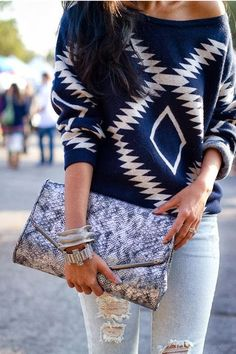 Distressed jeans and warm sweater