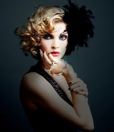 1920s hairstyles   1920 S Inspired Curly Bob Hairstyle With Feather Hair Accessory
