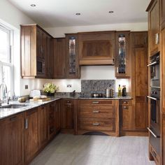 walnut kitchen (more pics at website) - color combination with floor