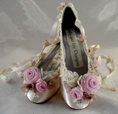 These beautiful fairy princess shoes have everything from lace to swarovski crystals.  The ribbonwork on these shoes is made using traditional