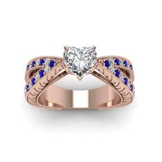 Pave Band 1 Ct. Heart Shaped Antique Diamond Split Shank Engagement Ring with Blue Sapphire in 14K Rose Gold exclusively styled by Fascinating Diamonds
