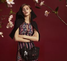 Update the classic pinafore dress with black and garnet patchwork. Style it with a blazer and a bag for a perfect look.