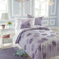 Fun #purple flowers on this Land Of Nod #bed. #toddlerroom