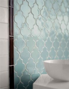 Love this unique bathroom tile! This would even look great as a backsplash in a French country themed kitchen!