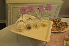 Serve a variety of mini cupcakes and display each one under a wine glass - attach a label to the top!  Takes the guess work out of which flavor guests choose!