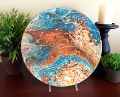 Acrylic pour painting, with cool texture, on vinyl record.