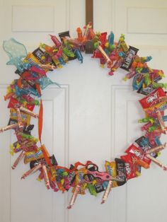 DIY Edible Candy Wreath. THIS is awesome. Even attach little scissors at the bottom so whoever's passing by can snip off a piece to enjoy. LOVE this idea.