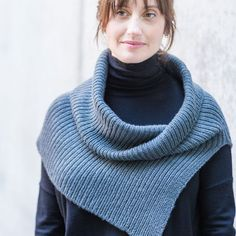 Bring some added polish to your winter wardrobe with the Half & Half cowl from Churchmouse. The first half of this ribbed cowl is knitted flat to split over one shoulder or create an opening in the front or back, then it's joined in the round for a softly draping cowl or collar. Knit in the soft and lofty Shibui Knits Drift, it's easy to wear any way you like!