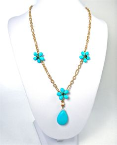 Liana Casanova Collection turquoise gemstone, Swarovski crystals, freshwater pearl, fancy golden chain necklace.  GemsSheGets.com