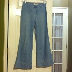 Adorable Tommy Hilfiger Flare Jeans Light blue denim, pocketless, high waist flare jeans. These jeans are super cute and super comfortable. Make for the perfect stylish, casual Saturday attire. Tommy Hilfiger Jeans