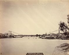 The Puente Colgante, originally called Puente de Claveria, was a suspension bridge that connected the Manila districts of Quiapo and Ermita across the Pasig River in the Philippines. Designed by the Basque engineer Matias Menchacatorre and completed in 1852, it was the first suspension bridge in Southeast Asia. The bridge was replaced by Quezon Bridge in the 1930s.(Wikipedia). Date Photographed: Circa 1870.