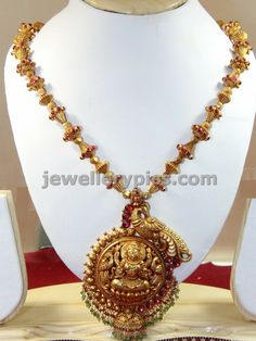 Antique peacock temple necklace design with lakshmi pendent - Latest Jewellery Designs
