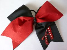 Cheer Bow Red Glitter & Black Two-tone with embroidered letter & bling.   $18 dawnsbowtique@hotmail.com https://www.facebook.com/DawnsBowtique