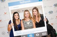 Guests posed with a prop designed like the Instagram app. It had several pre-written hashtags and a username from sponsor Alex and Ani, a jewelry brand.