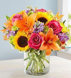 Send a vibrant bouquet of bright flowers like hot pink roses, orange lilies, and yellow sunflowers with our Florist Delivered Floral Embrace bouquet from Deliver sentiments of a warm embrace and brighten their day with this beautiful arrangement. 800 Flowers, Bright Flowers, Flowers Garden, Glass Flowers, Bright Pink, Wild Flowers, Small Flowers, Spring Flowers, Sunflowers And Roses