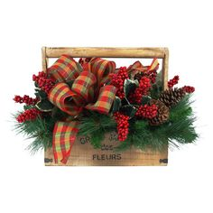 Faux pine branch and berry arrangement in a wood planter with ribbon accents.