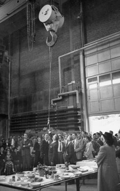 A bottle of champagne is delivered by crane for use in the christening of Columbia's cyclotron in 1948. Fritz Goro—Time & Life Pictures/Getty Images