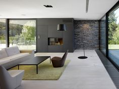 This great idea about fireplace in black wall near arch lamp in living room with…