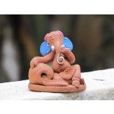 Artsy India brings you Colorful, Cheerful and Playful Ganesha idol made from Terracotta Clay. These are all Original designs made by local artisans.  Features: Unique and Special Design Handmade from (a type of clay) Painted with acrylic colors Colorful and Cheerful design Eco-friendly   Use: Gift to friends and family Gift festivals important events and other occasions As decorative showpiece figurine in your house / office Or simply to place it on shelf, table, show case, etc.