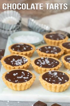 These mini salted chocolate tarts are super easy with only a few basic ingredients. Buttery tender shells with rich chocolate filling and a touch of salt. Mini Desserts, Sweet Desserts, Easy Desserts, Dessert Recipes, Mini Dessert Tarts, Plated Desserts, Oreo Desserts, Lemon Desserts, Salted Chocolate