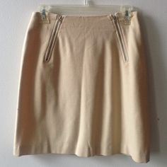 Nude Slanted Zippered Cotton Skirt One of my best finds! Found this while vacationing in the British Islands last year. Is in excellent condition, only been worn once. It is by Gunext. Size 6. Soft cashmere cotton skirt, fitted but also can unzip at waist so it is adjustable somewhat. Very chic simple style. Gunext Skirts Mini